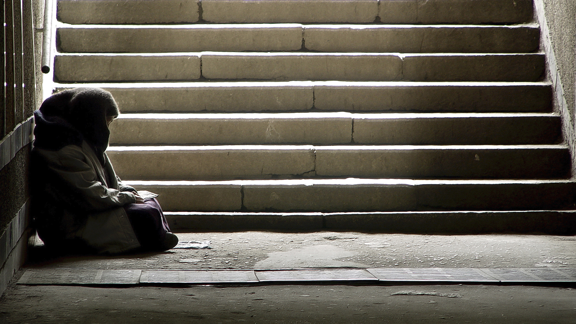 homeless-person-at-bottom-of-stairs